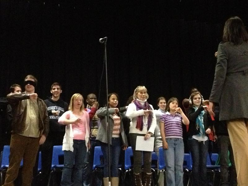 Rising+Starr+Chorus+teacher+Christie+Todd+leads+the+students+of+the+Special+Education+Music+Therapy+class+in+a+vocal+warm-up.+The+students+sing+a+musical+scale+and+use+hand+motions+for+each+of+the+eight+notes.+