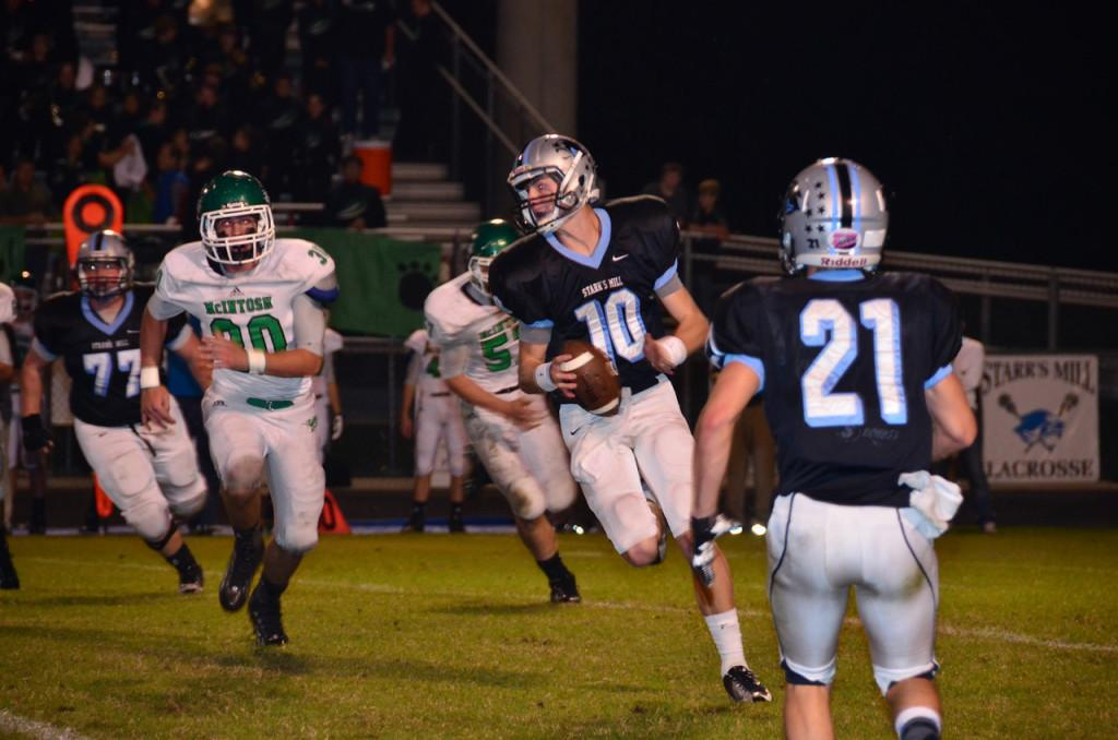 Senior quarterback Kyle Moseley tries to evade the McIntosh defense. Moseley went 15-for-22 with 216 yards and 2 touchdowns in the come-from-behind win against McIntosh, 42-27.
