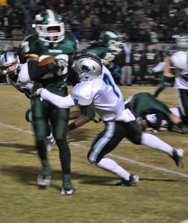Freshman safety Cole Gilley (7) makes a tackle during Friday nights game against Ware County.