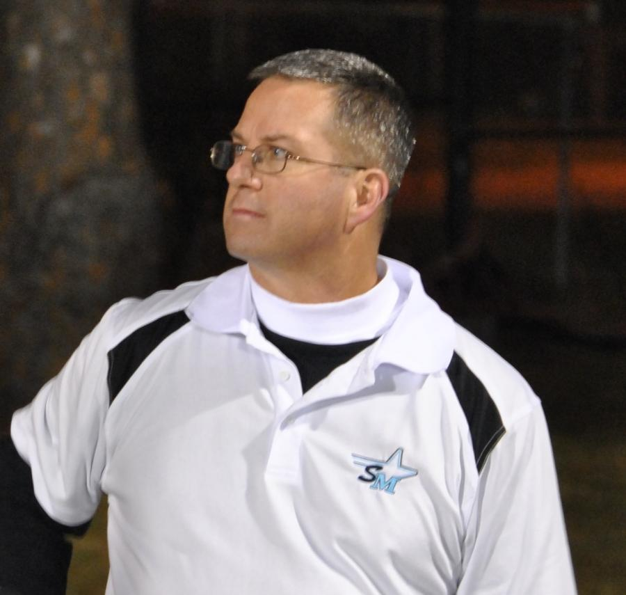 Scott King looks over the Panther Pride Marching band as its members prepare to take the field for one of its last performances of the season.
