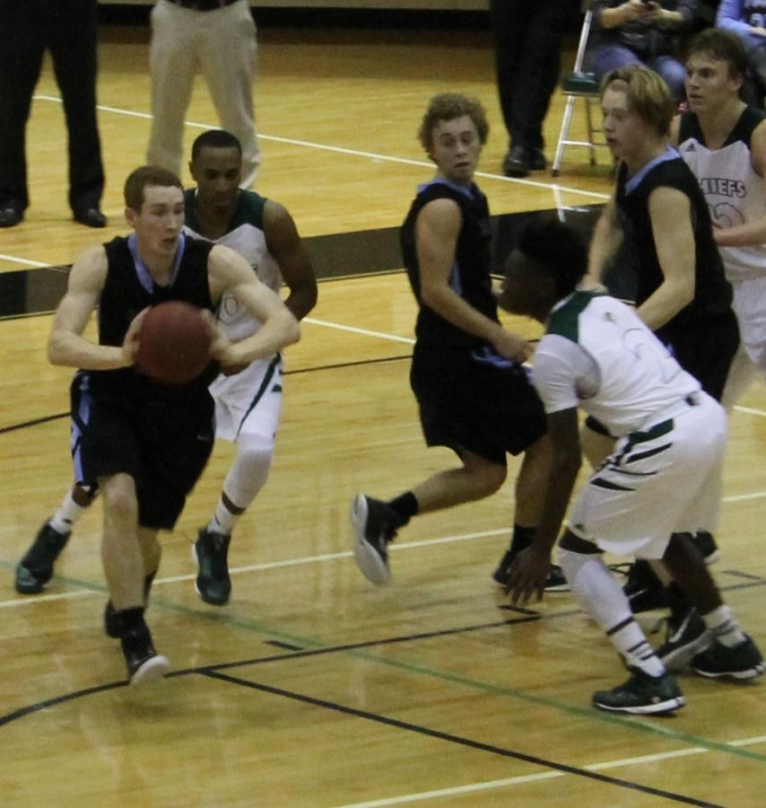 Senior forward Eric Sutliff passes the ball in the game against McIntosh. Sutliff tallied four points and seven rebounds.