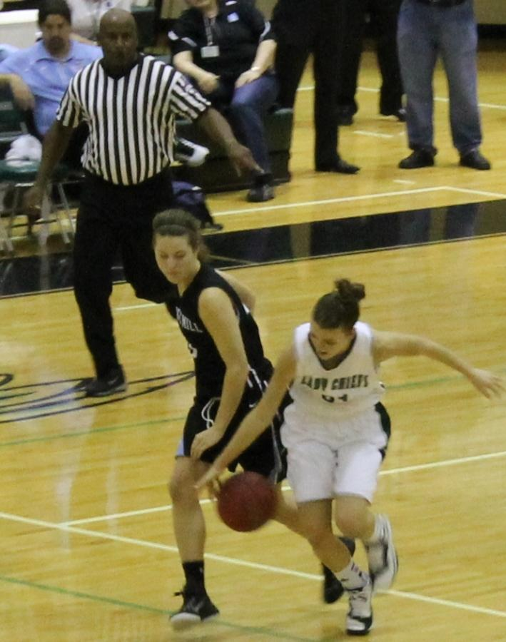 Senior Carly Pressgrove fights for the ball in the game against McIntosh. She finished with two points, three rebounds, and a steal.