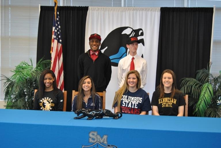 Seniors Chayla Park (from left), Jahmeil Curwen, Kayla Feigenbaum, Sam Roberson, Paige Betsill and Carly Pressgrove sign letters of intent to play soccer at various universities in the fall.