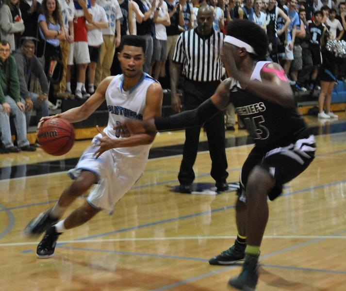 Senior guard Cedric Simmons drives to the basket against a McIntosh defender in the second meeting of the year between the Chiefs and Panthers.