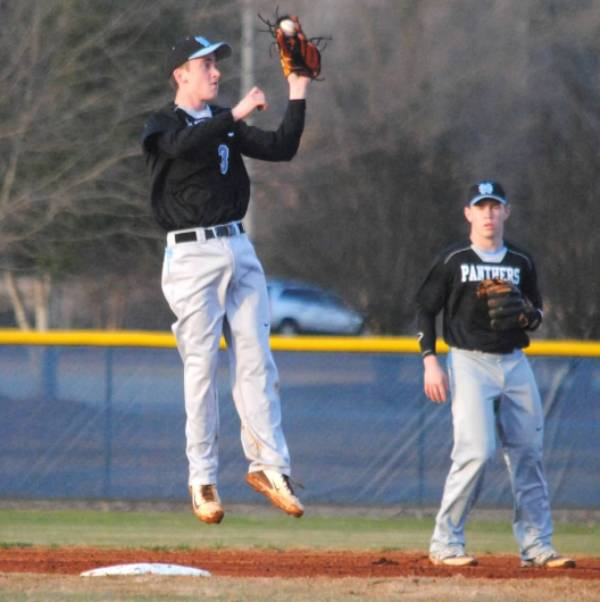 Junior shortstop and pitcher Richie Post makes a leaping catch at second base in the game at Jeff Davis. He is batting .471 on the year.