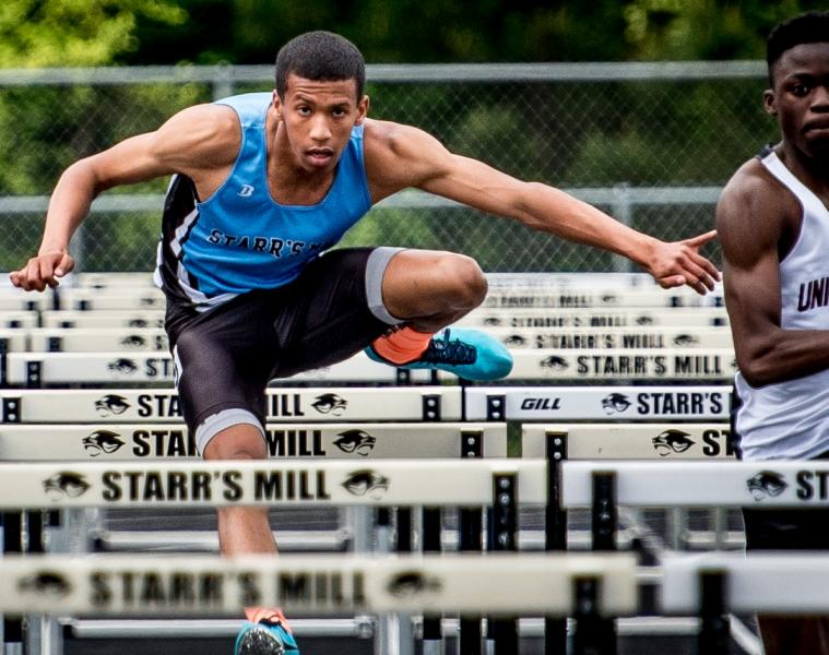 Senior Taylor Brunskole runs in the one of his two hurdle events, both of which he won during the second day of the Region 4-AAAAA championship.