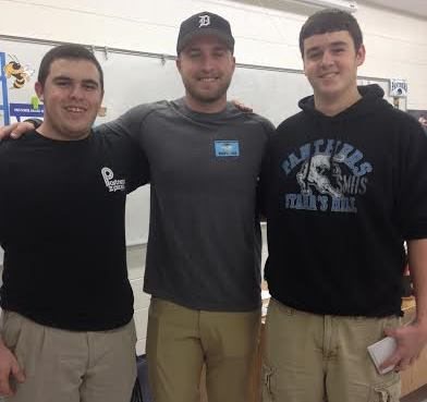 Former Panther Sam Martin (center) returned to his former high school for an interview and met with sports reporters Dylan Hynson (left) and Jack Fletcher.  The Lions drafted Martin with the 165th pick in the 2013 NFL draft.