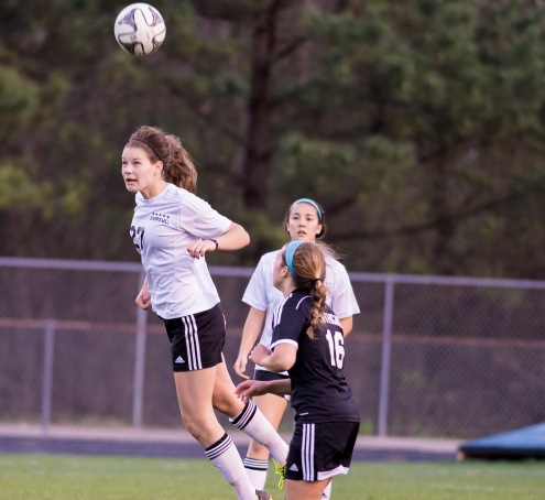 Junior Lauren Yoss heads the ball in the Lady Panthers' game against Northgate.