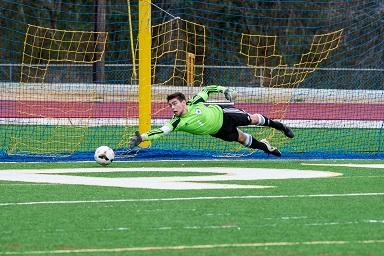 Senior Mitch Pattison makes a save in their 2-0 loss against St. Pius. The Panthers ended their season 14-5-1.  They lost to Clarkston in the Sweet 16 round of the state AAAAA playoffs.