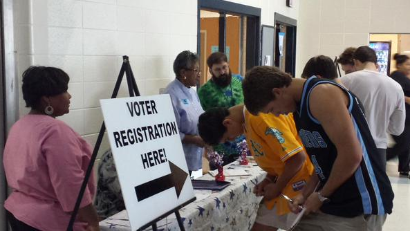 Seniors fill out voter registration forms in the cafeteria. Registration was available to all students ages 17 and a half and older during lunch on Sept. 24-25.
