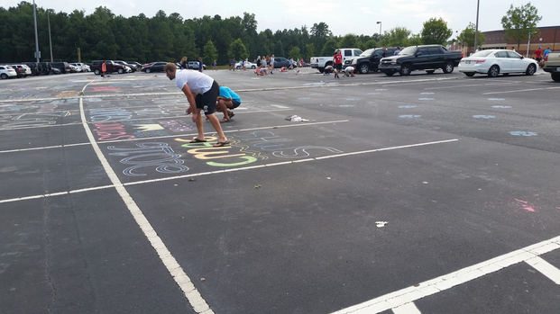 Seniors decorate the parking spaces in the student lot to celebrate the first day of their final year of high school. Many students of the Senior class get together the day before school and chalk their spaces to secure good spots and show their seniority to the underclassmen.