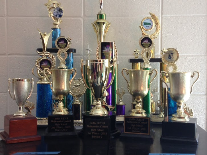 Math Team coach Wendy Willoughby displays numerous trophies from the team's previous victories. The team added to this collection last year with a first-place victory at the Griffin RESA tournament.
