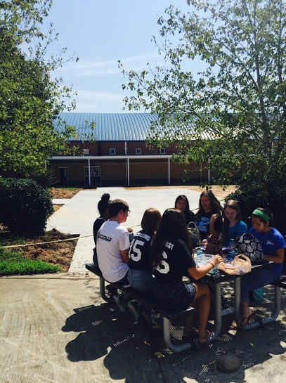 The new patio will be open for the students to use within the next couple weeks. It's located next to the existing eating area outside the cafeteria.