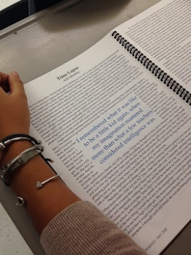 """A student reads junior Allie Bunting's piece, """"Time Lapse"""" in the 2015 issue of Musings."""