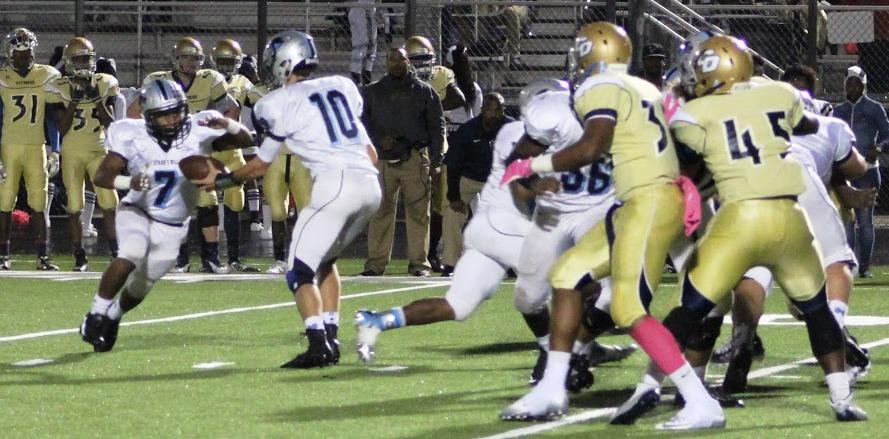 The Panthers ran for 467 yards against Drew, raising their season average to 327.2 yards per game, and scored six touchdowns on the ground in the game at Drew. Panther quarterback hands the ball to the running back on one of the 56 carries of the night.