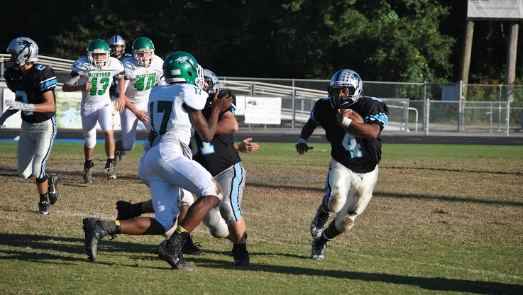 Sophomore running back Nick Brown races for the sidelines in attempt of reaching the first down.