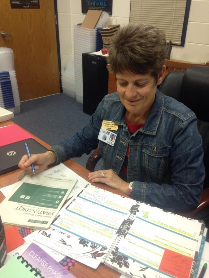 Assistant principal Deb Troutman works on scheduling the PSAT proctors so all teachers still have one planning period during the Oct. 14 testing.
