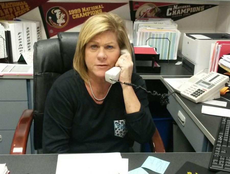 Guidance counselor Colleen Petty speaks on the phone with a parent during 7th period.