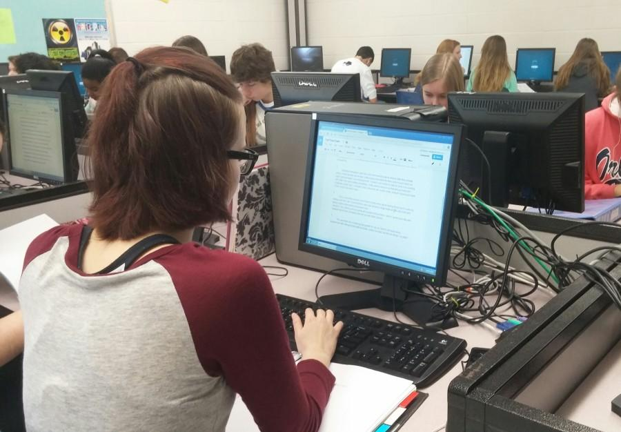 Freshman Ally Marlow sits in front of a computer screen for two hours taking her Writer's Workshop final exam.  Currently, students with five or fewer occurrences, excused or unexcused, can exempt one exam on attendance if they have a 71% or higher in the class.