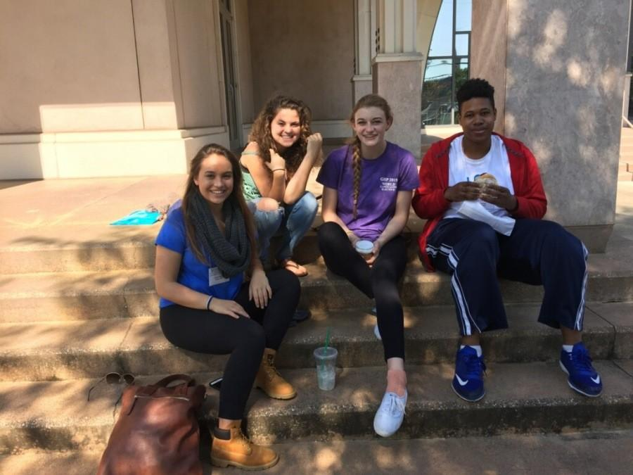 Seniors Hugh Walsh, Anna Hall, Katie MacLauchlan and junior Jordan Bobbitt sit on the steps of the Burd Center on lunch break.  For the two day conference, students could choose a multitude of workshops or shows to attend with two hour lunch breaks each day.