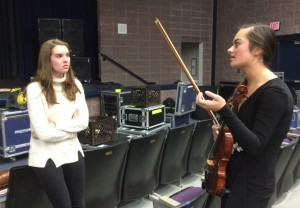 Hollyn Shadinger discusses the upcoming Miss Starr's Mill Pageant with fellow contestant senior Maddie Beatty during one of their practices.