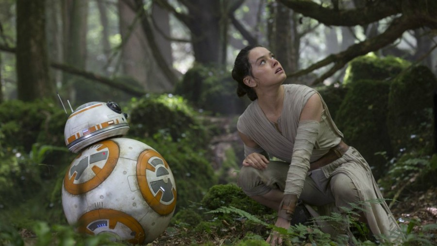 Rey (Daisy Ridley) and BB-8 watch as a First Order fleet circles above the planet Takodana in pursuit of information on Luke Skywalker's (Mark Hamill) whereabouts.