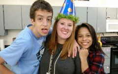 Adaptive curriculum specialist Courtney Savage and two of her students celebrate her birthday with cake and party hats. Savage said that she is honored to be chosen as Starr's Mill's teacher of the year.