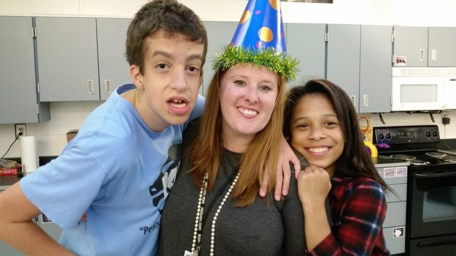 Adaptive+curriculum+specialist+Courtney+Savage+and+two+of+her+students+celebrate+her+birthday+with+cake+and+party+hats.+Savage+said+that+she+is+honored+to+be+chosen+as+Starr%E2%80%99s+Mill%E2%80%99s+teacher+of+the+year.+