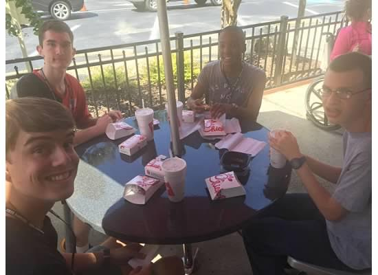 "Adaptive curriculum specialist Courtney Savage takes her students to Chick-fil-A to assist them with everyday life skills. ""It's important to take them out and get them to order their own food because it teaches them social skills,"" Savage said."