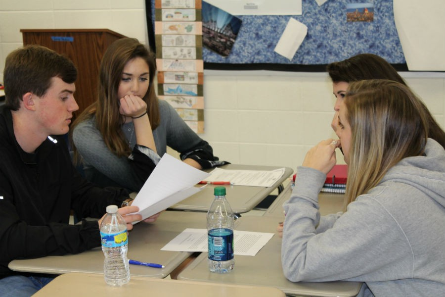 Diane Ruane's AP Government and Politics class learns how bills become laws through making and discussing their own bills in committees. Ruane encourages political participation in her students.