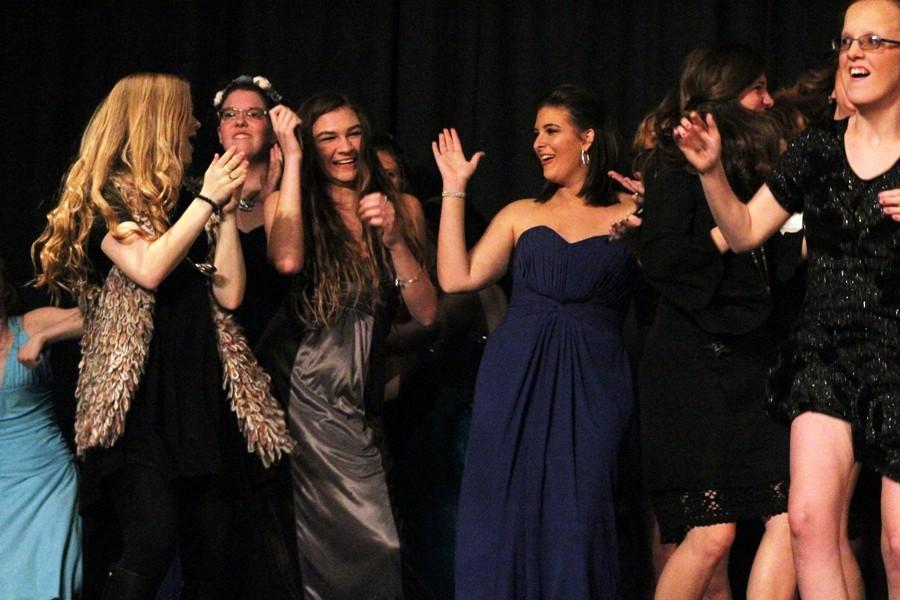 """All of the girls in the pageant take the stage and dance to """"Girls Just Wanna Have Fun"""" by Cyndi Lauper during the talent portion of the Peers are Linking Students club pageant."""