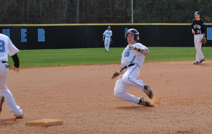 Feb. 6, 2016 - A Panther baseball player slides into third base during the split-squad scrimmage. Members of the varsity team played one another on Feb. 6 in preparation for their first home game scheduled for Feb. 22 against Union Grove.