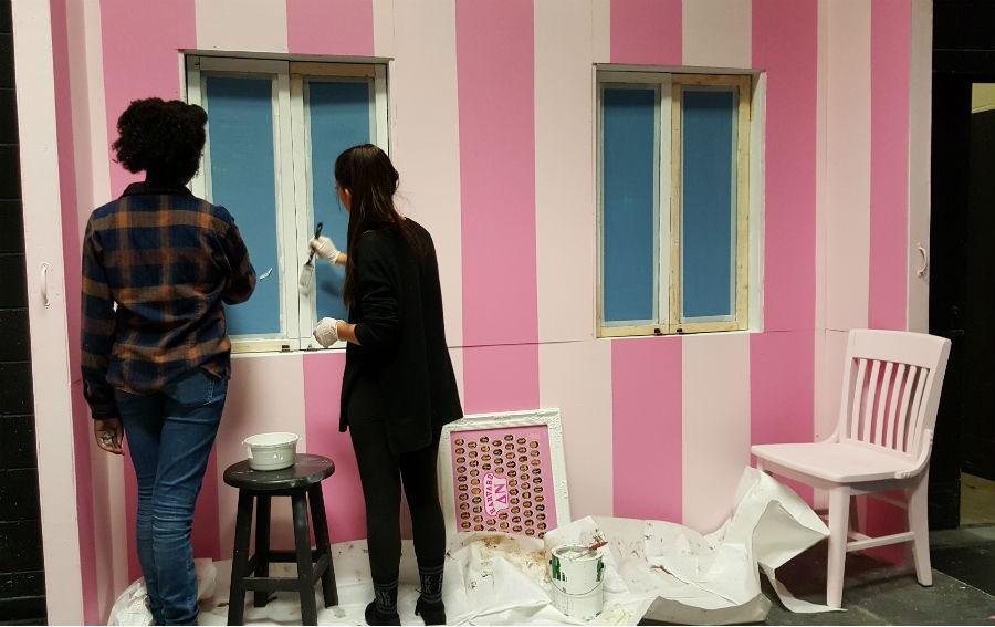 """Students paint the windows for the Delta Nu house interior in the Willie Duke Auditorium. Students and parents alike come together every year to assemble Starr's Mill's props and sets for the spring musical. """"Legally Blonde"""" will hit the stage this weekend, Friday and Saturday at 7 p.m. and Sunday at 3 p.m. Tickets are sold $10 for students and $14 for adults in the front office."""