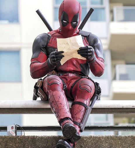 """Deadpool (Ryan Reynolds) sits on an overpass anticipating the arrival of A-Jax, the villain who cured Deadpool's terminal cancer and gave him super powers, but also severely disfigured him. """"Deadpool"""" has been a favorite in theaters since its release with its comedic take on a classic superhero movie."""
