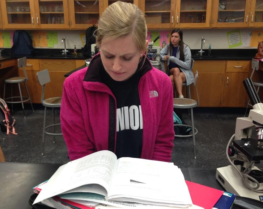 """Frustrated with long nights of college applications and school work, a senior in AP Biology has no desire to complete her work. """"Senioritis""""  has contracted among a large portion of the senior class, and this unmotivated state is caused by months of stress paired with the impending graduation day."""