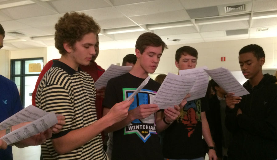 """The week of Dec. 7, students stayed after school in order to become more familiar with the choreography and vocals they would have to perform during their auditions. Here, a group of boys sings """"Serious"""" from one of """"Legally Blonde's"""" opening scenes."""