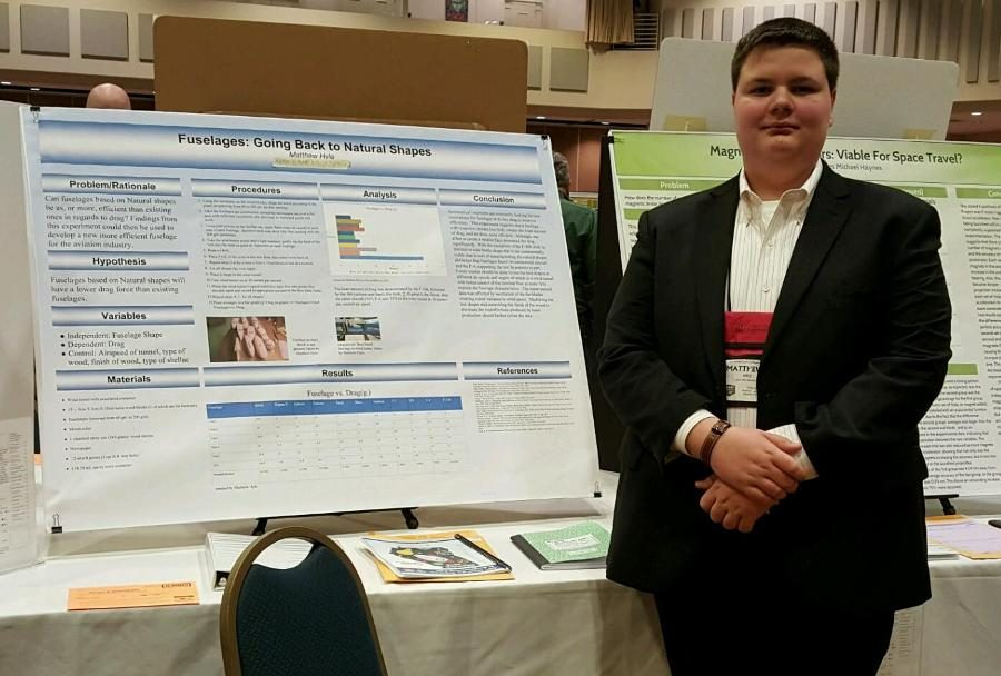 April 2, 2016 -Freshman science fair competitor poses next to his completed project at the Georgia Science and Engineering Fair. His project placed third at the state competition along with an award for ingenuity.