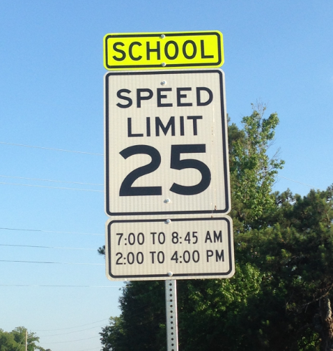 """School zone speed limit sign by Starr's Mill provides the hours the 25 mph speed limit is to be followed to enforce optimal safety. """"I believe that schools are safer now due to heightened school security, increased communication, increased awareness, emergency crisis plans, and bullying prevention programs,"""" assistant principal David McBride said."""