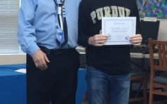 April 30, 2016 - Band director Scott King poses with a band signee after the signing day ceremony. The signee's trombone talent earned him a spot in Purdue University's All-American Marching Band.