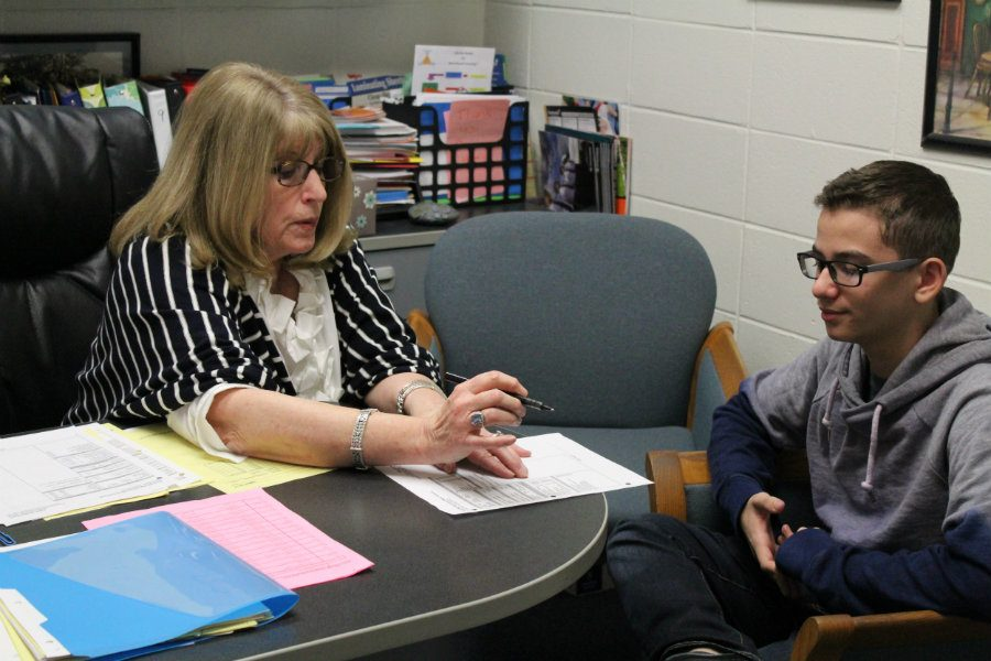 Dr. Sue Hutton helps a student register for his upcoming fall classes. The seven period day schedule has positively impacted students at the Mill, giving them numerous electives to choose from but has also forced teachers to make some changes in their lesson plans.