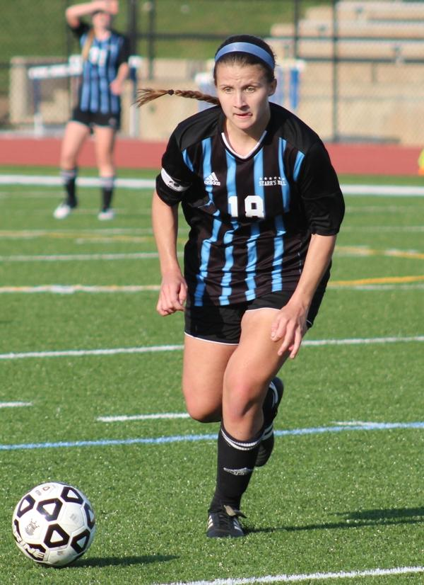 A Lady Panther soccer player dribbles the ball up field during a semifinal match against Columbus.