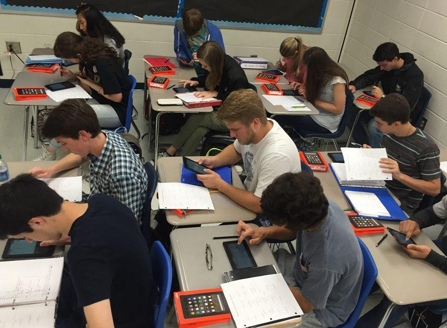 Juniors in math teacher JB Campbell's Accelerated Pre-Calculus class experiment with the new Kindle Fires provided to the math department by the PTSO. Every year, the PTSO provides material to teachers who requests for mini-grants.