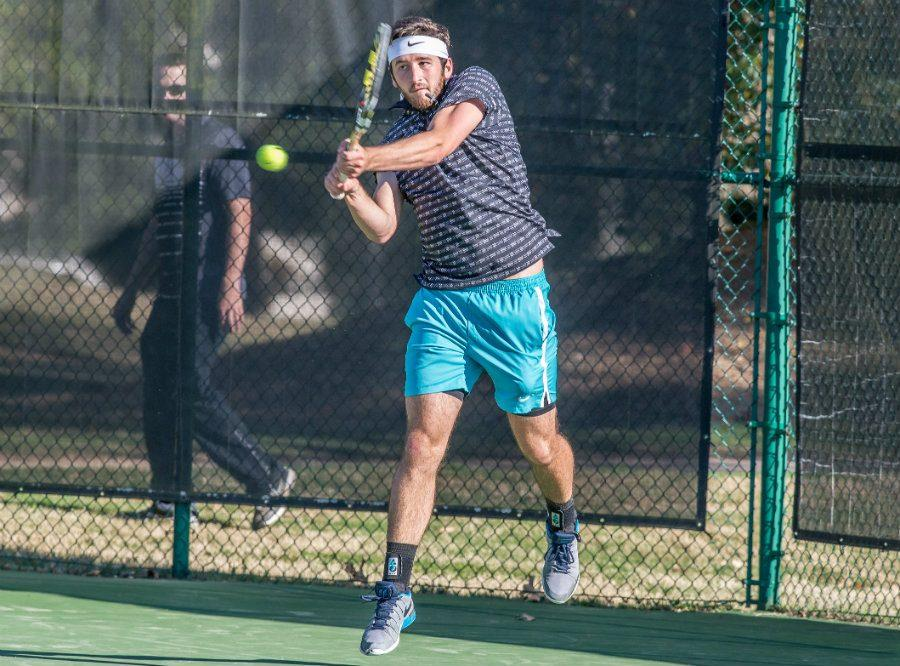 A senior jumps to send the ball flying back across the net with a backhand swing. With the boys' team graduating eight seniors, head coach Ronald Mann will look to the remaining underclassmen to continue the team's impressive region record and post-season success.