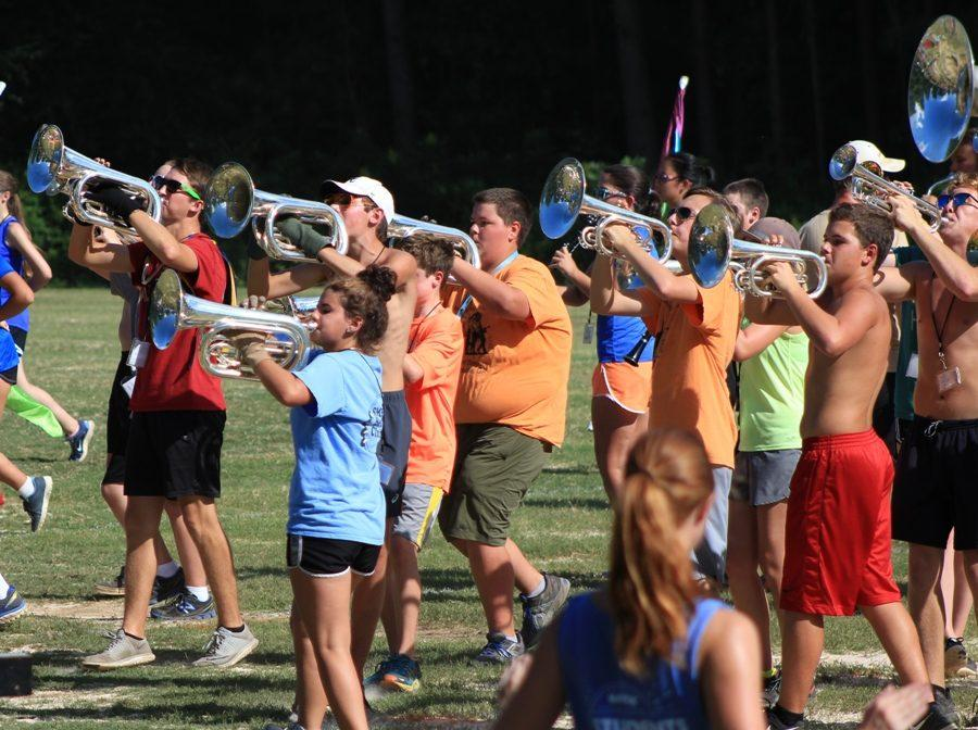 The band students practice this year's show after school on the practice field. Through the sweltering heat, the baritones push towards their drill spots.