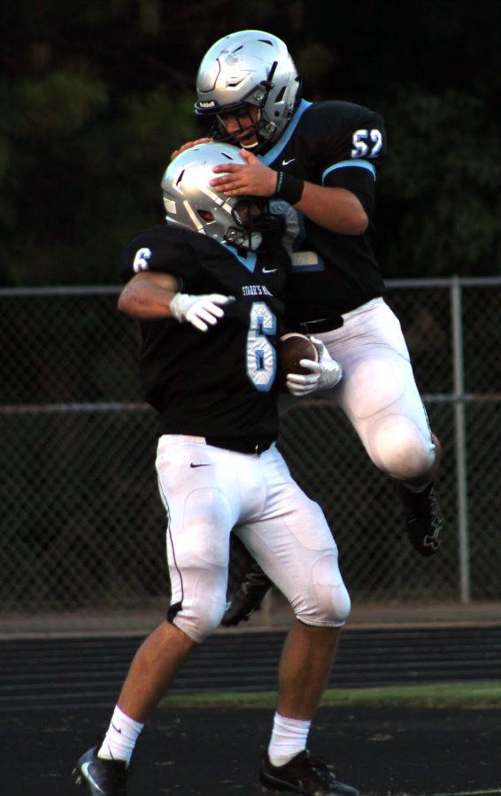 Aug. 12, 2016 - Two Panthers celebrate a touchdown in an aerodynamic manner during the first half of Friday's scrimmage. The Panthers ran the ball effectively against the Wildcats, leading to a 17-14 victory.