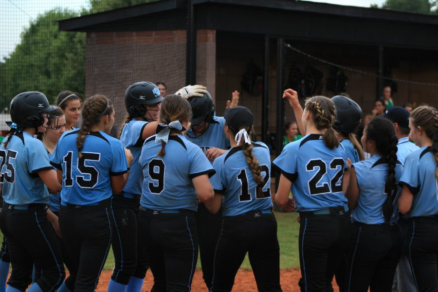 Aug. 16, 2016 - Panther varsity softball team gathers at home plate to celebrate an RBI against McIntosh. The Panthers went on to win the game for their second win of the season.
