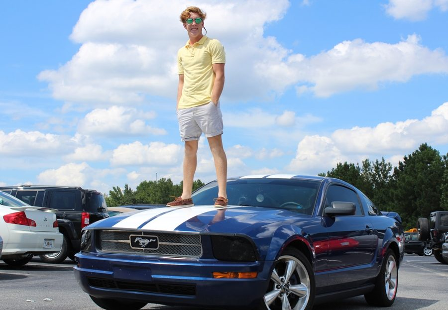 """A multitude of parking spaces at the Mill are home to lavish rides like this one, most of which come as birthday presents. """"I would say that, yeah, getting a car for your 16th birthday is expected around here,"""" Senior Abby Delbene said."""