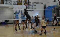 Varsity volleyball shows potential, falls to Johns Creek and Columbus in home opener