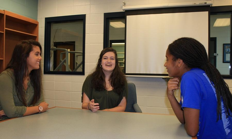 Junior Madison Martin explains her ideas for the new writing group to two students. The group will hold its first meeting at 7:00 p.m. on Sep. 15 at the Peachtree City Library in the readers and writers room.