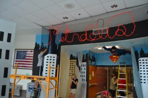 In preparation for homecoming week, members of the class of 2018 Executive Board and their parents, work diligently to finish the 700 hallway in superman paraphernalia. The homecoming pep rally will be held Friday at 2:55 p.m. in the gym.